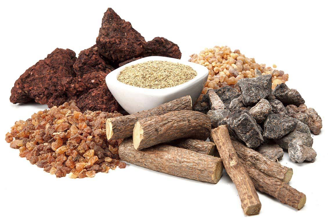 Frankincense, Myrrh, Dragon's blood, Gum guggal, Gum aloes, Licorice Roots arranged in a pile